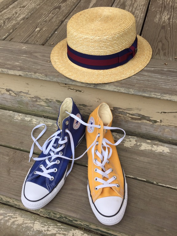 Straw Boater and Chuck Taylor Hi-tops.